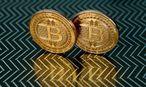 Bitcoins sind nur die Spitze des Eisbergs. Wozu die Technik dahinter imstande ist, begreifen Banken – wie viele andere Branchen auch – erst langsam. / Bild: APA/AFP/KAREN BLEIER