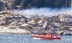 Rettungskräfte am Absturzort nahe Bergen / Bild: APA/AFP/NTB Scanpix/RUNE NIELSEN