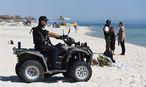 Terrorismus am Strand: Touristen zögern nach Attentaten mit einer Buchung nach Tunesien. / Bild: (c) APA/EPA/ANDREAS GEBERT