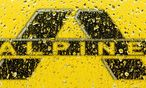 Alpine Bau logo is pictured through raindrops on a window in Vienna / Bild: (c) REUTERS (HEINZ-PETER BADER)