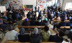Archivbild. Asylwerber bei einer rechtlichen Informationsveranstaltung in München. / Bild: APA/AFP/CHRISTOF STACHE