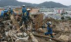 Aufräumarbeiten in Hiroshima. / Bild: (c) APA/EPA/KIMIMASA MAYAMA (KIMIMASA MAYAMA)