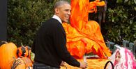 Obama receives children on the South Lawn for a Halloween trick-or-treating celebration in Washington