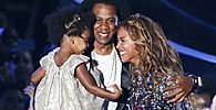 Beyonce smiles with Jay-Z and daughter Ivy Blue after accepting the Video Vanguard Award on stage during the 2014 MTV Video Music Awards in Inglewood