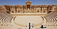 Tourists take pictures at the ancient Palmyra theater in the historical city of Palmyra