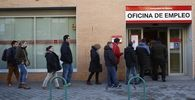 People enter a government employment office in Madrid