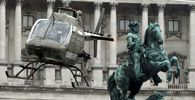 An Austrian army Bell OH-58 ´Kiowa´ helicopter hovers next to a statue of Prince Eugene of Savoy as it lands in Vienna