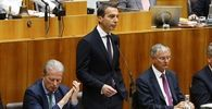 Austria's Chancellor Kern delivers a speech in the parliament in Vienna