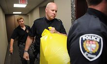 A police officer removes a package from the Conservative Party headquarters in Ottawa, Ontario, on Tu