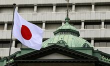A Japanese flag flies atop the Bank of Japan building in Tokyo