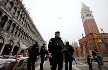 Italian Carabinieri officers patrol during the Venice Carnival at San Marco Piazza in Venice