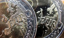 Euro coins are photographed in Frankfurt, Germany,  Monday, Sept. 12, 2011. Mounting fears over the p