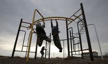 Children play in a playground in the Attawapiskat First Nation