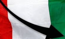Gold medal winner Molfetta of Italy carries a Italian national flag after his victory over Gabon's Obame in their men's +80kg gold medal taekwondo final at the ExCel venue during the London 2012 Olympic Games