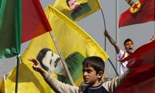 Demonstrators hold Kurdish flags and flags with portraits of jailed Kurdistan Workers Party leader Ocalan during a gathering to celebrate Newroz in the southeastern Turkish city of Diyarbakir