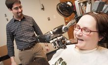 Undated photo showing paralysed woman demonstrating use of new mind-controlled prosthetic arm with intuitive control in Pittsburgh