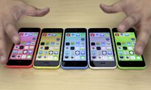The new iPhone 5C in five colours are placed together at Apple Inc's announcement event in Beijing