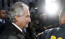 File photo shows Bernard Madoff  departing US Federal Court after a hearing in New York