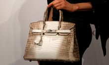 A model carries a Hermes signature Birkin with Himalayan crocodile leather during a preview in Hong Kong