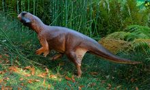 An artist´s illustration of Psittacosaurus, a little dinosaur with a parrot-like beak and bristles on its tail that roamed thick forests in China about 120 million years ago