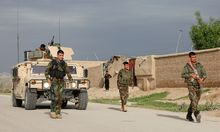 Afghan national Army (ANA) troops arrive near the site of an ongoing attack on an army headquarters in Mazar-i-Sharif northern Afghanistan
