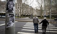 Hillary Clinton stickers are pictured on a street post near her campaign headquarters in the Brooklyn borough of New York