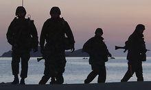 South Korean marines patrol along the beach of Yeonpyeong Island, South Korea, Friday, Dec. 10, 2010.