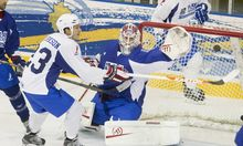 Goalie Jonas Gustavsson deflects a puck off the stick of David Clarkson in a NHLPA charity hockey game in Toronto