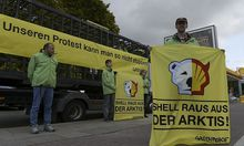 Greenpeace activists make a picket outside a Shell petrol station in Hamburg