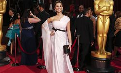 Actress Penelope Cruz, wearing a Giambattista Valli Haute Couture silk mousseline gown, poses for photos after arriving to the 86th Academy Awards in Hollywood, California