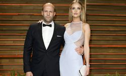 Statham and Rosie Huntington-Whiteley arrive at the 2014 Vanity Fair Oscars Party in West Hollywood