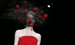 A model presents a creation by Italian designer Giorgio Armani as part of his Haute Couture Fall/Winter 2014-2015 fashion show for Giorgio Armani Prive in Paris