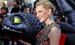 Actress Cate Blanchett poses on the red carpet with a figure of Toothless the Dragon character as she arrives for the screening of the film ´How to Train Your Dragon 2´ out of competition at the 67th Cannes Film Festival in Cannes