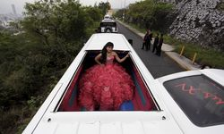 Sofia, who is dressed in an evening gown, poses inside a limousine during her 15th birthday celebration in Monterrey