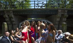 Dutch models present creations on a boat during the Canal Catwalk at the Floating Fashion Week in Amsterdam