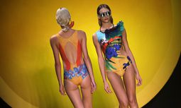 Models present creations from the Salinas Summer 2015 collection during Fashion Rio in Rio de Janeiro