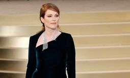 Actress Julianne Moore presents a creation by German designer Karl Lagerfeld as part of his Haute Couture Fall Winter 2015/2016 fashion show for French fashion house Chanel at the Grand Palais in Paris