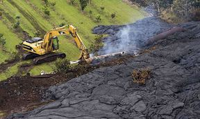 A construction crew tries to contain the lava flow from Mount Kilauea in Pahoa, Hawaii