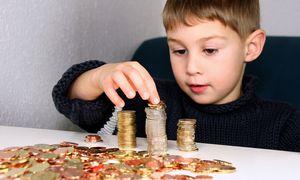 Kind mit Geld / Bild: (c) www.BilderBox.com (www.BilderBox.com)