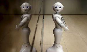 Robo-Banking: Humanoider Concierge-Roboter in der Mizuho Bank. / Bild: (c) REUTERS (YUYA SHINO)