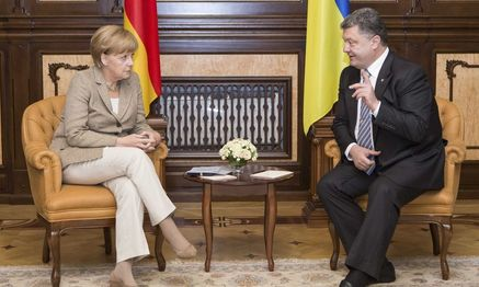 Merkel and Poroshenko / Bild: (c) REUTERS (POOL)
