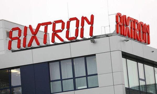 Beim Aixtron-Übernahmeversuch haben die USA die rote Karte für die chinesischen Käufer gezückt. / Bild: (c) APA/AFP/dpa/OLIVER BERG