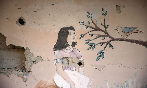Zerstörtes Wandbild einer Schule in Ghouta nahe der syrischen Hauptstadt Damaskus  / Bild: REUTERS
