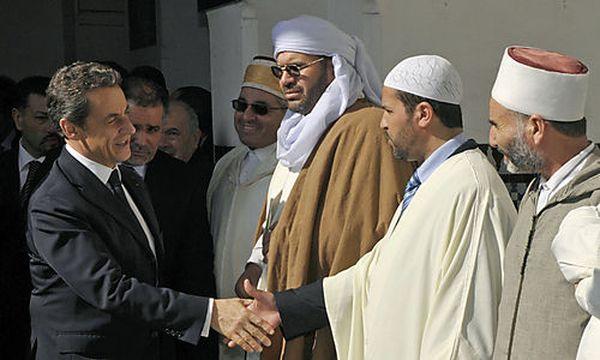 Archivbild: Nicolas Sarkozy schüttelt Vertretern der französischen Muslime die Hand / Bild: (c) AP (Philippe Wojazer)