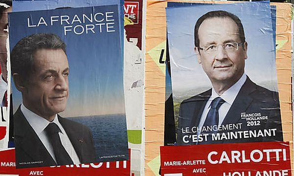 Wahlplakate von Amtsinhaber Sarkozy und Herausforderer Hollande / Bild: (c) AP (Claude Paris)