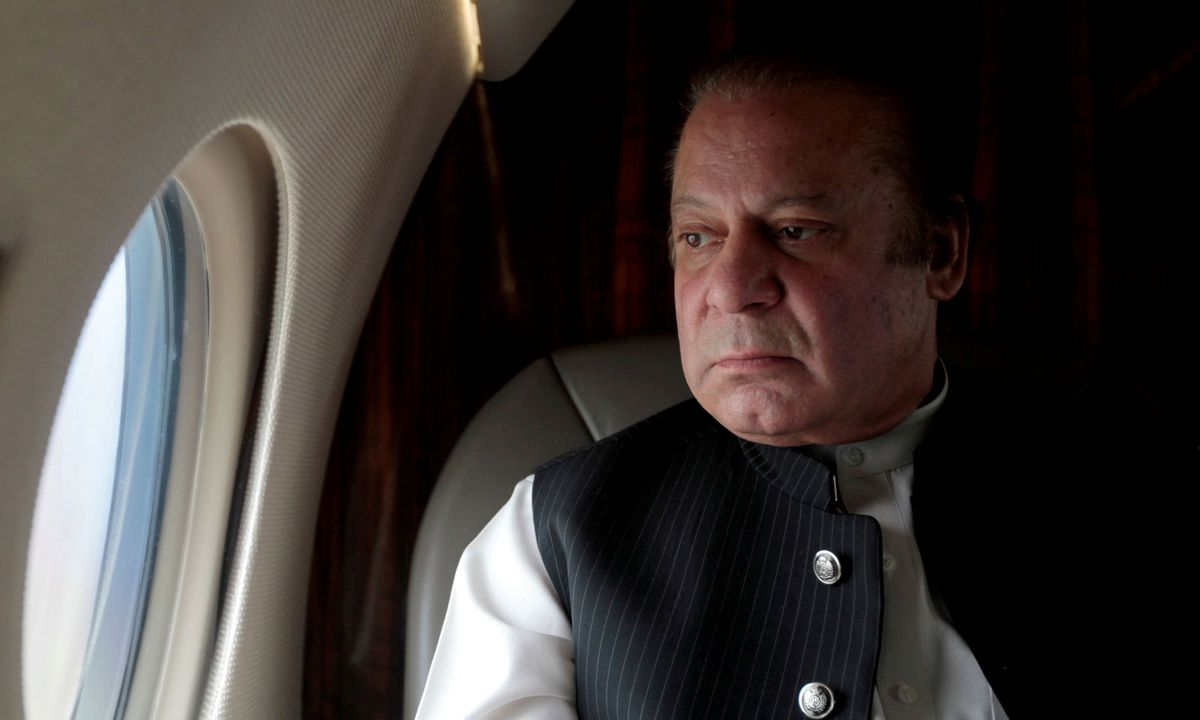 File photo pakistani prime minister nawaz sharif looks out the window of his plane after attending a ceremony to inaugurate the m9 motorway between karachi and hyderabad 150126293128828 v0 l